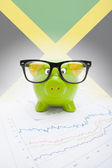 Piggy bank with flag on background - Jamaica — Stock Photo
