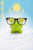 Piggy bank with flag on background - Kazakhstan — Stock Photo