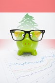 Piggy bank with flag on background - Lebanon — Stock Photo