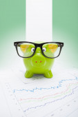Piggy bank with flag on background - Nigeria — Stock Photo