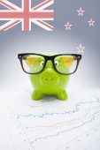 Piggy bank with flag on background - New Zealand — Stock Photo