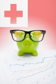 Piggy bank with flag on background - Tonga — Stock Photo