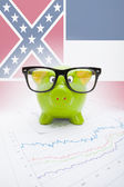 Piggy bank with US state flag on background - Mississippi — Stock Photo