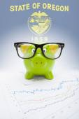 Piggy bank with US state flag on background - Oregon — Stock Photo