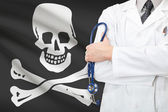 Doctor with Jolly Roger flag on background — Stock Photo