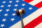 Wooden judge gavel over USA flag - closeup shoot — Stock Photo