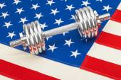 Metal dumbbell over US flag as symbol of healthy nation — Stock Photo