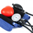 Blood pressure measuring tools with red toy heart - studio shoot - 1 to 1 ratio — Stock Photo #53579623