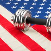 Dumbbell weights over USA flag as symbol of healthy nation - 1 to 1 ratio — Foto de Stock