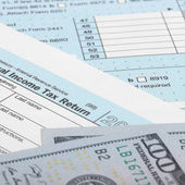 US Tax Form 1040 with 100 US dollar bills - 1 to 1 ratio — Stock Photo
