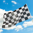 Checkered flag waving in the wind with white clouds on background - 1 to 1 ratio — Stock Photo #53580657
