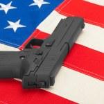Handgun laying over USA flag - studio shoot - 1 to 1 ratio — Stock Photo #53580717