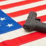 Handgun over USA flag - studio shoot - 1 to 1 ratio — Stock Photo #53580745