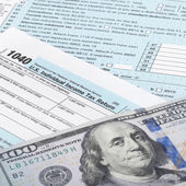 USA Tax Form 1040 with calculator and 100 US dollar bills - 1 to 1 ratio — Stock Photo