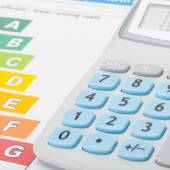 Calculator with energy efficiency chart - 1 to 1 ratio — Stock Photo