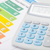 Energy efficiency chart with calculator - 1 to 1 ratio — Stock Photo