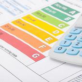 Energy efficiency chart with calculator - studio shot - 1 to 1 ratio — Stock Photo