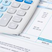 Receipt next to calculator - studio shot - 1 to 1 ratio — Stock Photo