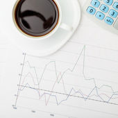 Coffee cup over some financial documents - view from top - 1 to 1 ratio — Stock Photo