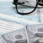 US Tax Form 1040 with calculator and 100 dollars - 1 to 1 ratio — Stock Photo