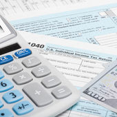 US Tax Form 1040 with calculator and US dollars - 1 to 1 ratio — Stock Photo
