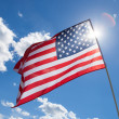 USA flag with blue sky and sun on background - 1 to 1 ratio — Stock Photo #53911055