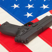 Handgun over US flag - 1 to 1 ratio — Stock Photo