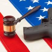 Judge gavel and gun over big US flag - 1 to 1 ratio — Stock Photo