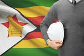 Architect with flag on background  - Zimbabwe — Stock Photo