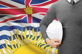 Engineer with flag on background series - British Columbia — Stock Photo