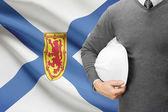 Engineer with flag on background series - Nova Scotia — Stock fotografie