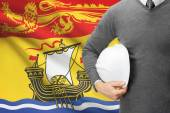 Engineer with flag on background series - New Brunswick — Stock Photo