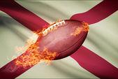American football ball with flag on backround series - Alabama — Stock Photo