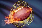 American football ball with flag on backround series - Nebraska — Stock Photo