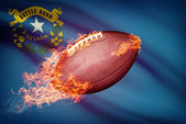 American football ball with flag on backround series - Nevada — Stock Photo