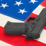 Handgun over USA flag - studio shoot - 1 to 1 ratio — Stock Photo #55147785
