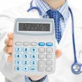 Doctor with calculator in hand - 1 to 1 ratio — Stock Photo