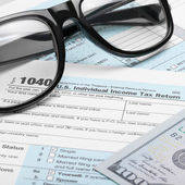 US Tax Form 1040 with dollars and glasses - 1 to 1 ratio — Stock Photo