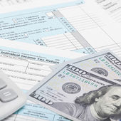 US of America Tax Form 1040 with calculator and dollars - 1 to 1 ratio — Stock Photo