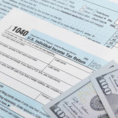US Tax Form 1040 with 100 dollars bills - 1 to 1 ratio — Stock Photo