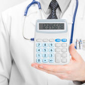 Doctor holdling calculator - heath care concept - 1 to 1 ratio — Stock Photo