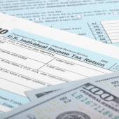 USA Tax Form 1040 with USA dollars bills - 1 to 1 ratio — Stock Photo