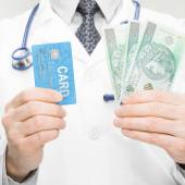 Doctor holding money and credit card - 1 to 1 ratio — Stock Photo