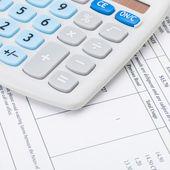 Studio shot of receipt and calculator - 1 to 1 ratio — Stock Photo