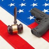 Gun and judge gavel over USA flag - studio shoot - 1 to 1 ratio — Stock Photo
