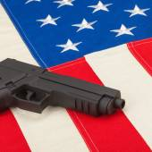 Gun over USA flag - 1 to 1 ratio — Stock Photo