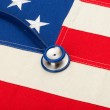 Stethoscope over US flag - heath care concept — Stock Photo #57471019
