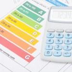 Neat calculator with energy efficiency chart - studio shot — Stock Photo #57471215