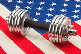 Dumbbell over USA flag — Stock fotografie