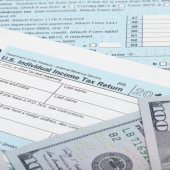 US Tax Form 1040 with 100 US dollar bills — Stock Photo